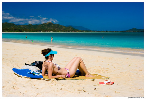 My honey on the beach at Kailua Bay on east Oahu.  Yes, the water is that blue!